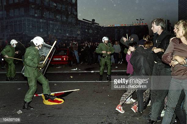 Some thousand people demonstrate against German reunification on the Alexander Platz in former East Berlin on October 03 1990 Fortyfive years after...