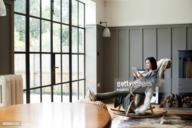 some time for herself before the baby comes - rocking chair stock photos and pictures