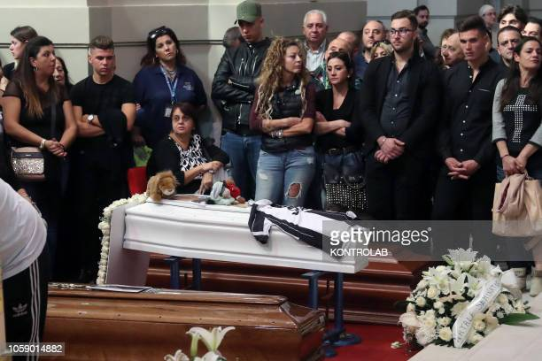 Some toys on the coffin of one of the children who died in the tragedy of Casteldaccia during the funeral of the nine victims of the flood in Palermo...