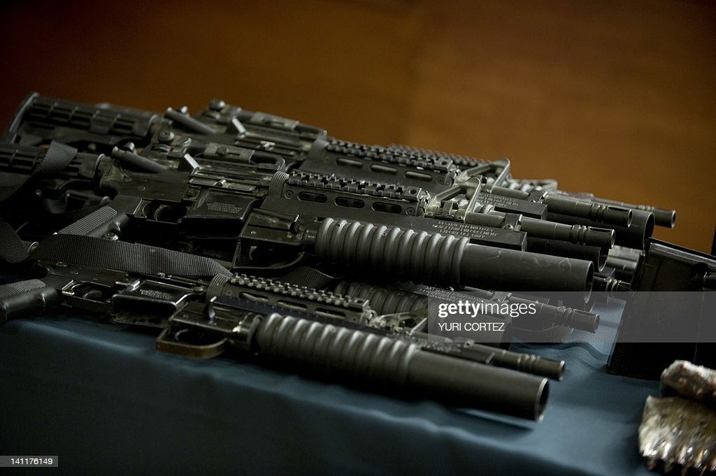 Some US made M4A1 rifles with grenade launchers, part of an arsenal