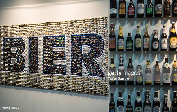 Some varieties of beer are placed next to the bottle caps lettering 'BIER' on January 19 2016 in Berlin Germany