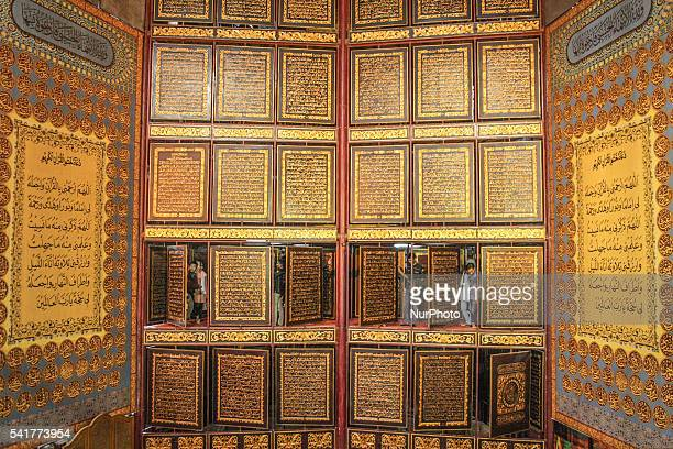 Some visitors enjoy the beauty of the temple carvings Quran Alakbar at boarding IGM Alihsaniyah Palembang Sunday June 19 2016 Al Quran giant with a...