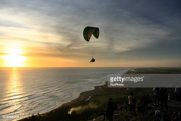 Some visitors enjoy the sunset from the hill Parangndog Yogyakarta Indonesia on January 6 2015 Hill at the edge of the southern coastal region of...