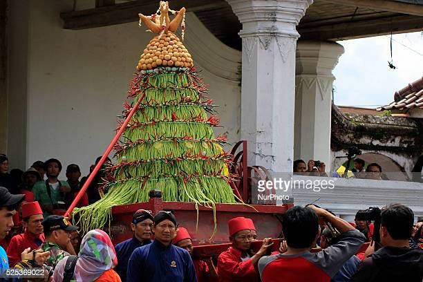 Some volunteers of Kraton Palace known as 'Abdi Dalem' bring a quotgununganquot during the procession Grebeg Maulud Yogyakarta Palace at the Great...