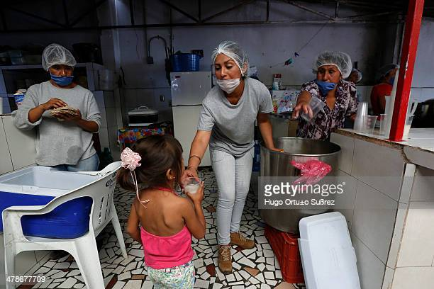 Some volunteers prepare food for the population affected by the spillage of molasses in the dam El Hurtado and left more than 500 tonnes of dead fish...