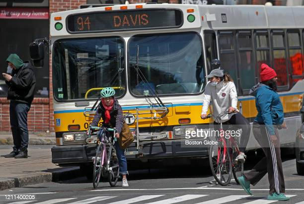Some wear masks and some go without masks in Somerville, MA on April 29, 2020. Somerville will require face masks in public beginning Wednesday March...