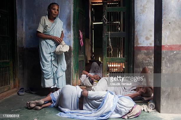 Some widows resting a bit before going into another room to sing Bhajan Kritan in the Sri Bagwan Bhajan Ashram in Vrindavan. Those widows come to the...