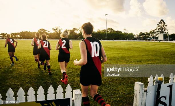 some wish for it, we work for it - afl stock pictures, royalty-free photos & images