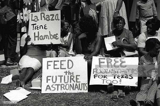 Some women are protesting while waiting for the launch of Apollo 11 mission To watch the famous departure a million of tourists gathered in Cape...