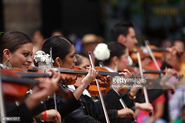 CONTENT] GUADALAJARA JALISCO MEXICO SEPTEMBER 01 Some women play their violins during the parade for the 20th anniversary of the International...