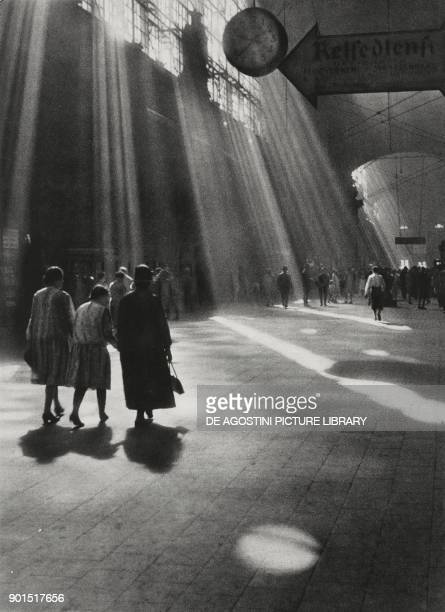 Some women portrayed by back while walking in a station photo by Paul Wolff fotografie d'arte from L'illustrazione Italiana year LX n 20 May 14 1933