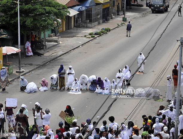 Some women pray during a march against outgoing president Laurent Gbagbo organised by Ivorian women on February 28 2011 in the Treichville popular...