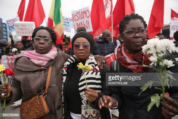 Some women with flowers during the demonstration that took place in Naples against racism and for Idy Diene a Senegalese street vendor killed in...