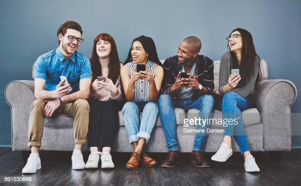 some would call them the social generation - people in a row stock pictures, royalty-free photos & images