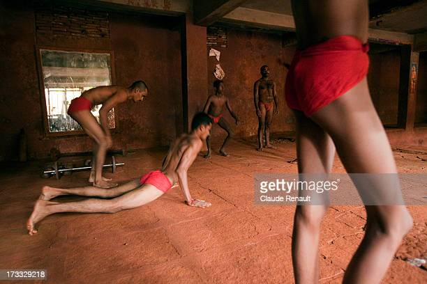 Some wrestlers doing some warm up excercises before a session of training inside the Shahupuri Talim wrestling club, a Kusti Akhara in Kolhapur.
