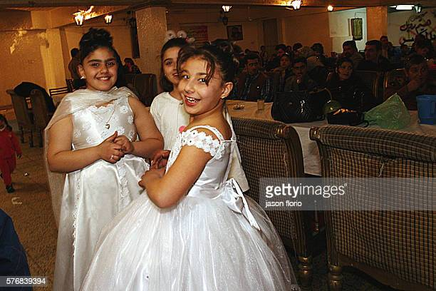 Some young bridesmaids enjoy themselves at a Christian Assyrian wedding held at Le Palestine Hotel in Baghdad Monday and Thursday nights have been...