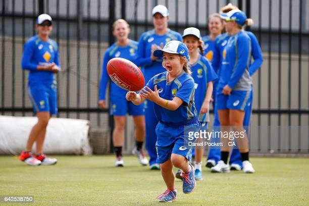 Some young fans participate in some warmup drills with the players during a Southern Stars training session at Melbourne Cricket Ground on February...