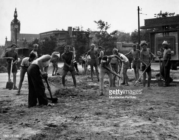 Some young members of the voluntary work brigades digging up Poland 1955