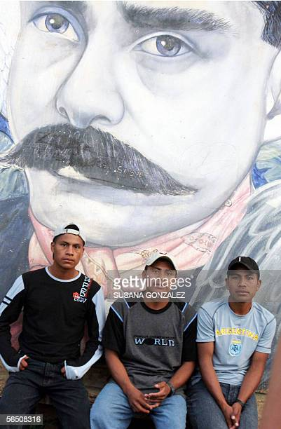 Some zapatista wait in La Garrucha in front of portrait of Emiliano Zapata 31 December 2005 The zapatistas will start their Zapatista rally in Mexico...