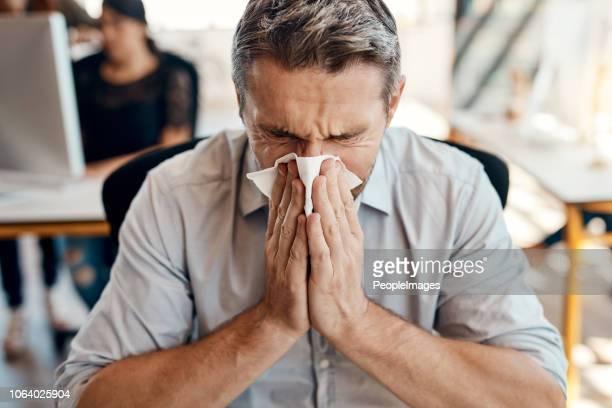 somebody should have gotten his flu shot - starnutire foto e immagini stock