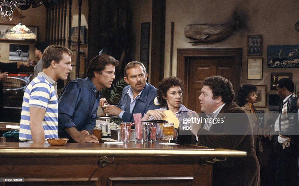 CHEERS -- 'Someday My Prince Will Come' Episode 3 -- Aired 10/17/85 -- Pictured: (l-r) Woody Harrelson as Woody Boyd, Ted Danson as Sam Malone, John Ratzenberger as Cliff Clavin, Rhea Perlman as Carla Tortelli, George Wendt as Norm Peterson