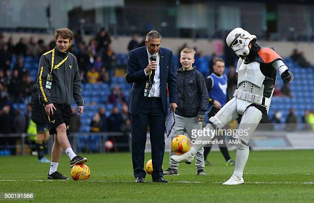 Someone dressed as a stormtrooper from Star Wars takes part in the half time crossbar challenge during the Emirates FA Cup Second Round match between...
