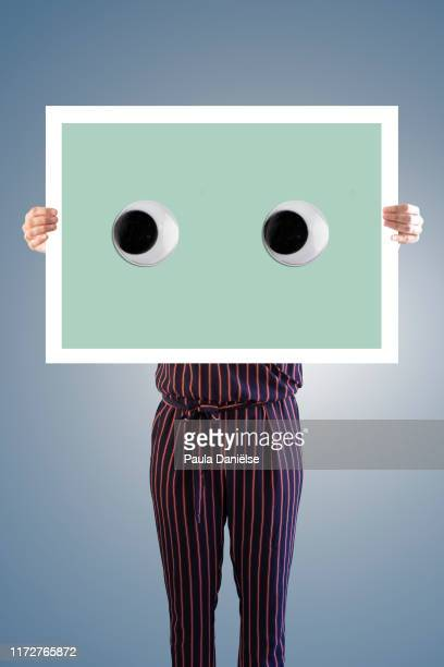 someone holding paper with google eyes - googly eyes stock pictures, royalty-free photos & images
