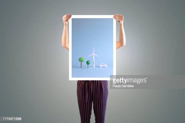someone holding poster - poster stock pictures, royalty-free photos & images