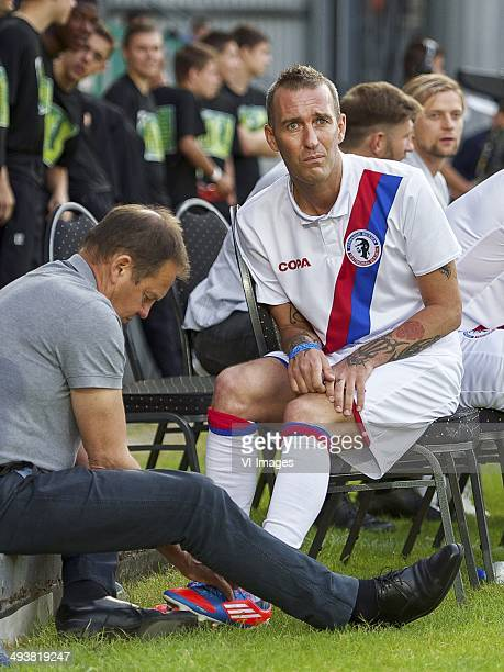 someone is helping Fernando Ricksen of Team Fernando Ricksen with his shoe lace during the Fernando Ricksen benefit game on May 25 2014 at the...