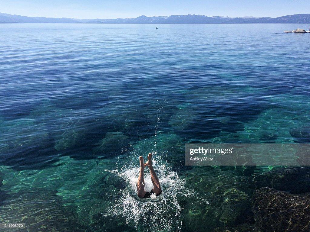 Someone jumping into Lake Tahoe : Stock Photo