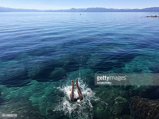 someone jumping into lake tahoe - koningschap stockfoto's en -beelden