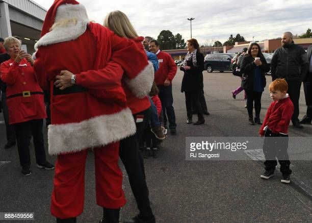 Someone maybe on the naughty list as Santa greets volunteers and families before the start of the Denver Santa Claus Shop on December 8 2017 in...