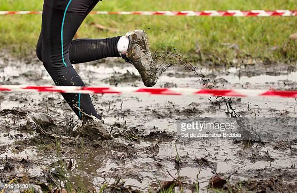 Someone running through the mud. Muddy shoes.