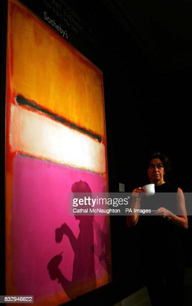 Someone walks past the White Center by Mark Rothko from the collection of David Rockfeller at Sotheby's London which is due to fetch 25 million at...