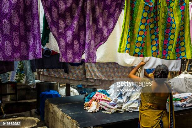 someone who is working in the laundry - who stock pictures, royalty-free photos & images