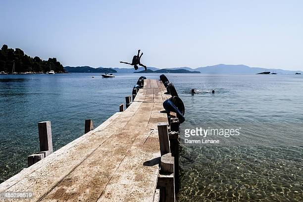 Somersault off of jetty