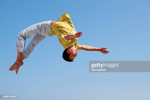 somersault - acrobatic activity stock photos and pictures