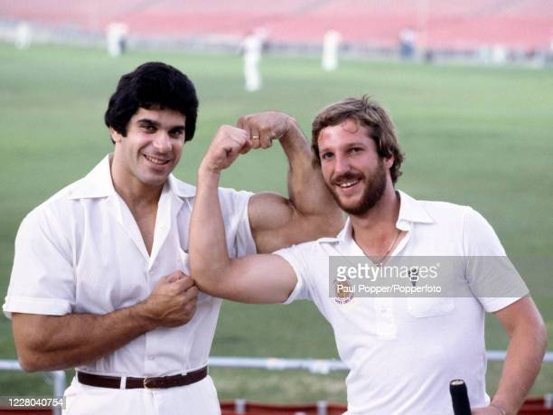 Somerset and England cricketer Ian Botham compares his biceps with Lou Ferrigno, the 'Incredible Hulk' at the Dodger Stadium in Los Angeles, United...