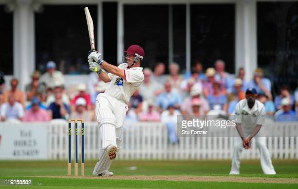 Somerset batsman Andrew Strauss pulls a ball to the boundary during day one of the tour match between Somerset and India at the county ground on July...