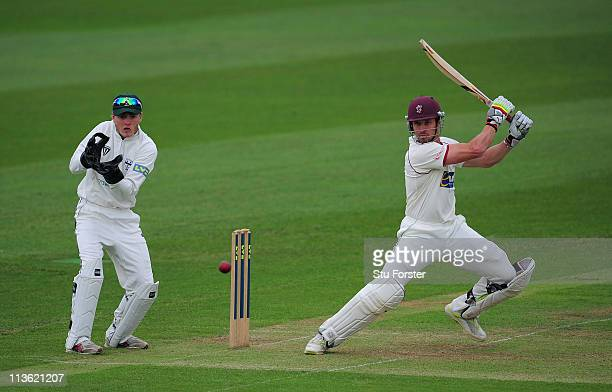 Somerset batsman Nick Compton cuts a ball to the boundary watched by wicketkeeper Ben Cox during day one of the Division One LV County Championship...