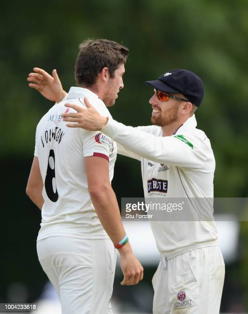 Somerset bowler Jamie Overton celebrates with Jack Leach after dismissing Worcestershire batsman Moeen Ali during Day two of the Specsavers County...