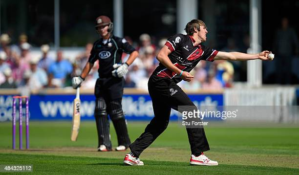 Somerset bowler Jamie Overton fields a shot from Surrey batsman Rory Burns off his own bowling during the Royal London OneDay Cup match between...