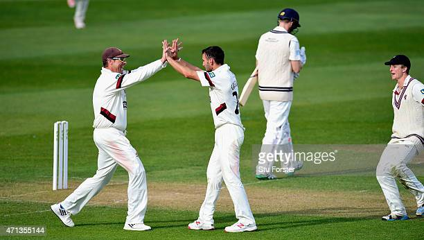 Somerset bowler Lewis Gregory celebrates with captain Marcus Trescothick after taking the wicket of Middlesex batsman Adam Voges for 98 during day...