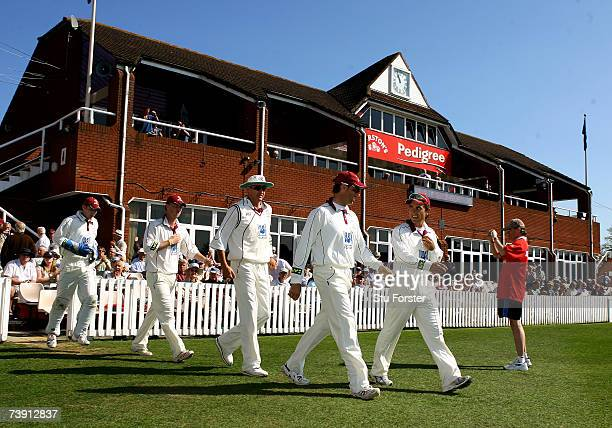 Somerset captain Justin Langer leads his team out to field including Marcus Trescothick on the first day of the Liverpool and Victoria County...
