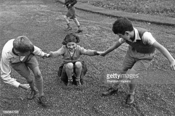 Somerset children wearing shoes made by Clarks who are researching the durability of their children's footwear July 1955 To encounter every form of...