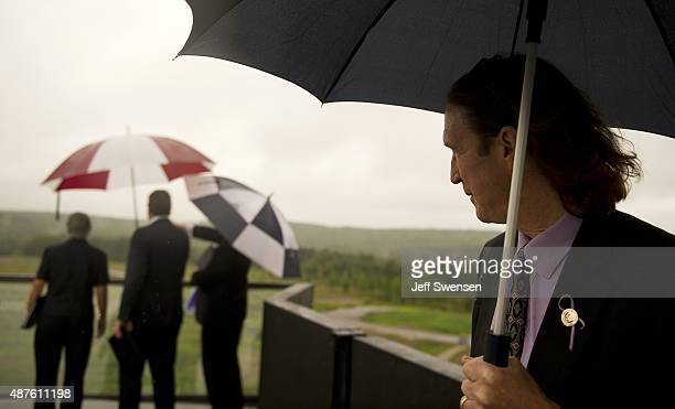 Somerset County Coroner Wally Miller braves the rain to look out over the grounds at the visitor center at the Flight 93 National Memorial on...