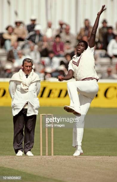 Somerset Fast Bowler Joel Garner in action watched by Umpire Donald Oslear during a Benson and Hedges match against Essex at Chelmsford in May 1983...