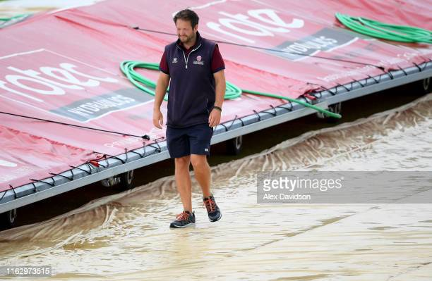 Somerset head groundsman Simon Lee inspects the covers during Day Two of the Kia Women's Test Match between England Women and Australia Women at The...