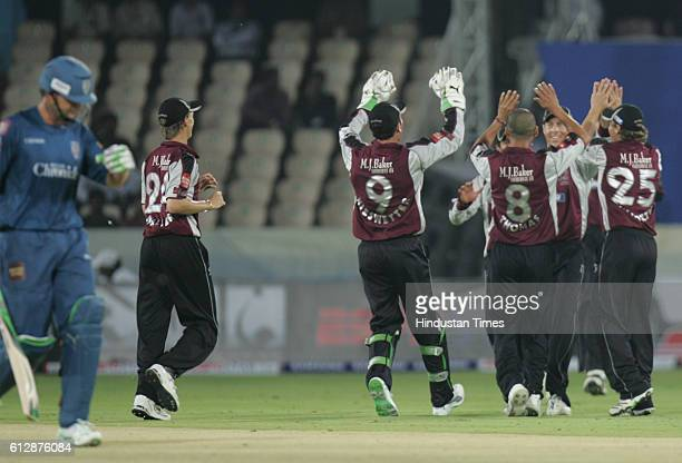 Somerset playerscelebrate the wicket of Adam Gilchrist of the Chargers during the Airtel Champions League Twenty20 Group A match between the Deccan...
