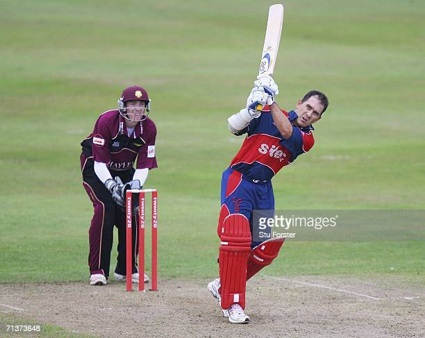 Somerset Sabres batsman Justin Langer pulls a ball to the boundary watched by Northants wicketkeeper Rikki Wessels during the Twenty20 match between...